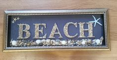 "Gold framed ""Beach"" with a large mix of sea shells"