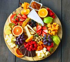 How to make the BEST Fruit and Cheese Board ndash Modern Honey-How to make the BEST Fruit and Cheese Board. An assortment of cheeses, fresh fruits, dried fruits, nuts, and spreads. A perfect party appetizer platter. Cheese Fruit Platters, Cheese And Cracker Tray, Meat And Cheese Tray, Food Platters, Wine Cheese, Best Cheese Platter, Charcuterie Cheese, Cheese Food, Charcuterie Board