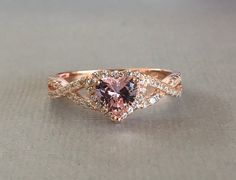 This listing is for a Heart Shape Simulated Simulated Pink Morganite rose gold Over Sterling Silver ring   *********product Description*********  This beautiful Heart Simulated Pink Morganite stone measure 6mms The Accent stones are simulated diamonds  The metal is 925 Sterling silver with a rose gold plating This also includes a beautiful gift box   *********Shipping Information*********  All packages are shipped via USPS First Class Mail unless you choose a faster shipping method  The…