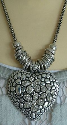 Solid silver heart with beautiful sparkly gems in the flower pattern
