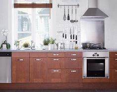 I like the lines in the cabinets and the colors here.  This kitchen feels warm and inviting to me.