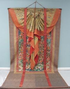This thangka, owned by the Mead Art Museum at Amherst College, was conserved by the staff at Museum Textile Services. Here you can see the thangka and its accompanying silk veil. Thangkas function as objects of Buddhist meditation. They are also used as teaching aids and serve as a visual recording of history. Each thangka has a central painting surrounded by a fabric mount, usually made of Chinese silk. This fabric can become damaged over time from rolling, moisture, light exposure and the…