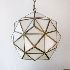 Large Vintage Andalusian or Arabic pendant lamp from 1960-70s. Milk glass and brass forming a honeycomb-like geometric pattern.    Stunning