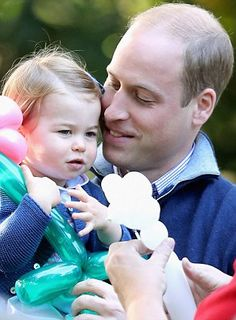 Pictured, Prince William with his daughter Princess Charlotte...