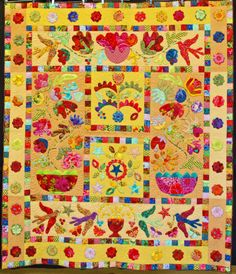 Flower Pots by Ursula Krogue.  Kaffe Fassett fabrics, Kim McLean designs.  First place, Large Applique category, 2013 Boise Basin Quilters Guild show.