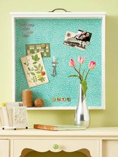 Turn an old drawer into a bulletin board/shelf. Can even add a tile of sheet metal to make it magnetic...then cover with either fabric, paint, wallpaper or contact paper.
