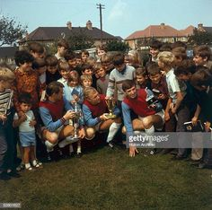 A crowd gathered around the three West Ham footballers left to right Geoff Hurst Bobby Moore and Martin Peters who are each holding a trophy Geoff Hurst, Martin Peters, Stock Pictures, Stock Photos, Bobby Moore, Bbc Broadcast, Editorial News, West Ham