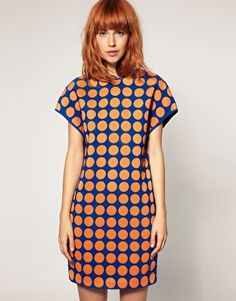 Complimentary polka dots make a dazzling dress.