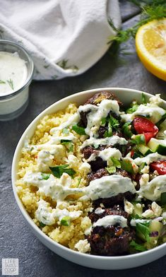 Cool Mom Eats weekly meal plan: The best part of this Greek Bowl with Meatballs over Couscous at Life Tastes Good is that it makes for a great packed lunch the next day too. Here's how!