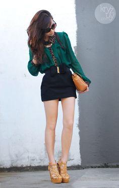 Mini skirt + flowy blouse + sky-high heels = fun outfit.