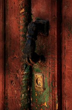 .I love faces and body parts.  Look at the wear on this handle - so many people have gone through these doors - what did they find?  Where were they going?  What needs do they have?