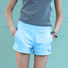 """[forever 21] shorts in sky blue 4) [forever 21] sky blue shorts with silver size zips. 2 front pockets. cute shorts for casual wear. 88/12: poly/elastane. 2"""" inseam, 15"""" across laying flat, 10"""" from top to btm. Great condition Forever 21 Shorts"""