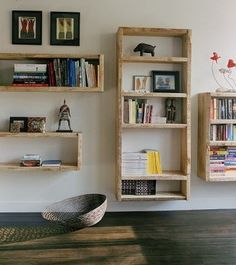 hanging exposed wood bookshelves