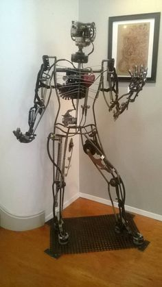 Steampunk Robot. Made from recycled materials. Chainsaws, engine parts, recliner, old film camcorder, torch, springs, gauges, etc. Alkolai Arts by Matt Bellefeuille on Facebook. Metal sculpture