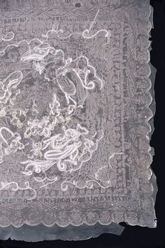 """Ai Matsumoto, Japan. Imprint of hand embroidered hankerchief, trapped between panels of silicone.  (via Crafts Council """"Lost in Lace"""" exhibition on Flickr)"""