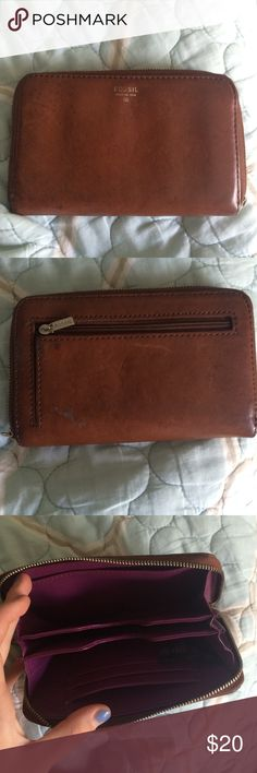 Fossil Wallet Brown leather fossil wallet• missing wrist band• zipper broken but is fixable • very worn Fossil Bags Wallets