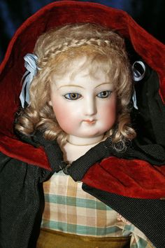 Hand-wefted mohair doll wig with crown braid.