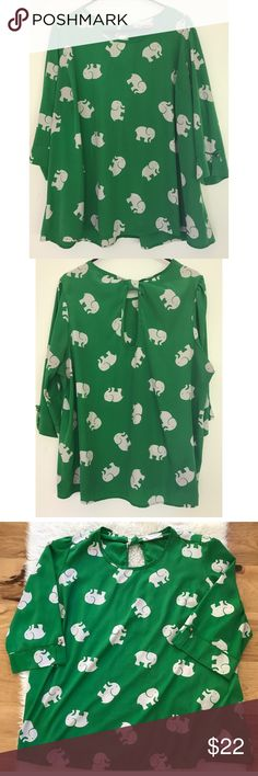 "Peace Love CA Elephant Print Green Tunic Blouse Still in excellent pre-loved gorgeous bright green Tunic Blouse from Peace Love California in size 3X. No major flaws. Keyhole cut out in the back with cute white elephant print on the Tunic. Measure about 29"" length, 24.5"" pit to pit, 17.25"" sleeves. ❌No trades or modeling. Open to reasonable offers. Thank you‼️ ModCloth Tops Tunics"