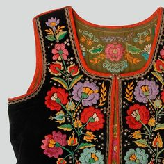 Woman's bodice of black velvet. Decorated with haberdashery trimmings, buttons, sequins and embroidery. Fastened with hooks and eyes. Hand and machine-sewn.  Western Krakowiak Folk, Kraków-Bronowice (?) or Modlnica area (?), P. Kraków, probably 1920s-1930s