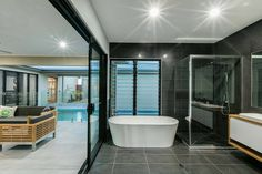 What a stunning and timeless bathroom designed and built by Dixon Homes Cairns