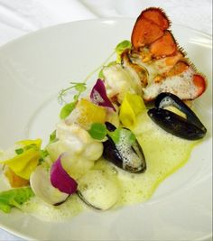 Lobster, Clams and Mussel, truffle tortellini, roasted pineapple, Green peas