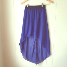 Dark blue high low skirt Very whimsical blue high low skirt. Has a mini under skirt layer because the majority of the material is see-through. Long in back almost to floor. Had black stretchy band around waste. Skirt had a seem down the skirt in the back. New with tag! Skirts High Low