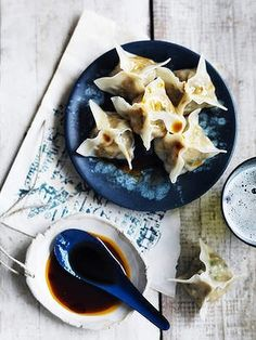 Prawn wontons with chilli oil and soy sauce.