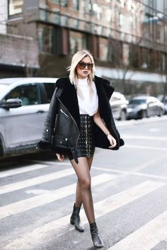 Street Style Danielle Bernstein is rocking a hot winter style here, in a monochrome outfit consisting of a striking buckled leather skirt, a whit Fashion Mode, Fashion Outfits, Womens Fashion, Fashion Trends, Skirt Fashion, Street Fashion, Prep Fashion, Ootd Fashion, Fashion News