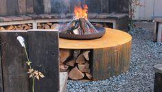 Corten steel firepit with storage for logs