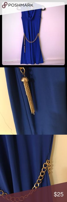 Cowl neck blue stretchy gold chain belt dress This dress is a STUNNER! This dress is stretchy, sways a bit when you walk, and truly turns heads. I've worn it twice with many compliments! It no longer fits but it's truly beautiful and I think you'll be thrilled with it! Dresses