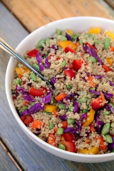 This beautiful veggie-packed quinoa salad is under 350 calories, offering 13 grams of protein and seven gra...
