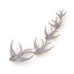 AN IMPRESSIVE DIAMOND SWALLOW BROOCH comprised of five graduated brooches mounted on a single fitting, circa 1910