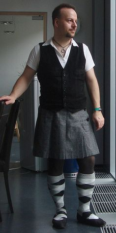 """This man breaks gender binary through fashion as he decides the whole store is for him. He buys and wears what he wants regardless of the section it is in. """"Men have two arms.  Women have two arms.  Men have two legs. Women have two legs.  Legs and arms, in both cases, are connected by a torso which is, genitals included, more or less the same.  Tops must have holes for a head and two hands.  Pants must have holes for feet. """""""