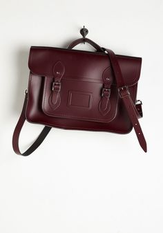 Cambridge Satchel Company Bag in Oxblood - 15 inch. This ultra stunning, rich brown satchel, designed by Cambridge Satchel Company in the UK, is absolutely saturated with style. #red #modcloth