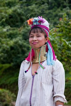 In Northern Thailand, near Chiang Mai, there is a tribe of Karen people, the Padaung, whose women wear brass neck rings to elongate their necks, a sign of beauty. • Buy this artwork on home decor, stationery, bags, and more.