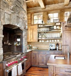 Wood Kitchen Cabinets Design at Rustic Interior with Exposed Stone ...