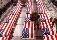 This photo vividly depicts the cost of keeping America's freedom. Anguish and sadness are felt for both the soldiers that died and the ones that are still alive to bear the loss. The photo shows soldiers saying a final goodbye to their fallen brothers and sisters in arms.