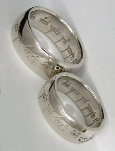 "The elvish inscription reads, ""One ring to show our love, one ring to bind us, one ring to seal our love and forever entwine us."""