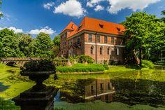 XV century's Oporow Castle, moat and the park, Poland