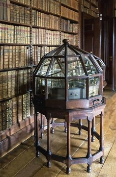 The Library, at Dunham Massey,England, displays an orrery under a glass dome. This is an old Georgian house which is under the auspices of the British National Trust for Histoic Building. Beautiful Library, Dream Library, Library Books, Hogwarts Library, Famous Monuments, Home Libraries, Public Libraries, Georgian Homes, Book Nooks