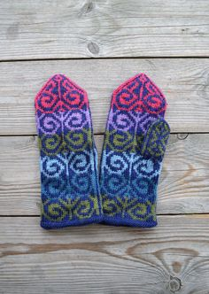 Hand-knit wool mittens are colored like the northern lights. Crochet Mittens, Mittens Pattern, Knitted Gloves, Knit Crochet, Hand Knitting, Knitting Patterns, Crochet Cross, How To Purl Knit, Knits