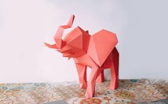 A desk elephant to add flair on your work desk, coffee table or book shelf. A little more than a foot, its big enough to be displayed yet space conscious. Size: w*15.7 inches x h*12 inches