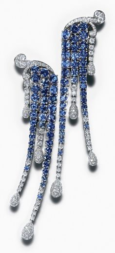 Earrings of sapphires and round brilliant diamonds cascade like waterfalls.