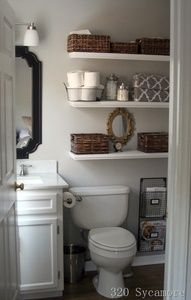 Cute small bathroom! Great storage ideas with shelves and baskets