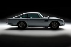 RM Auctions announces the consignment of one of the most significant cultural icons of the century – the 1964 Aston Martin James Bond movie car – to its annual 'Automobiles of London' event at the Battersea Evolution in London on October, 2010 Aston Martin Lagonda, Classic Sports Cars, Classic Cars, Classic Auto, Porsche, Audi, James Bond Cars, James Bond Movies, Ayrton Senna