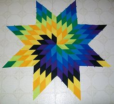 I love the spiral of color for this Lone Star quilt.  I have not seen it done like this before - so pretty and striking!