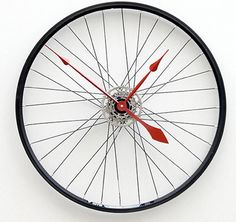 Bicycle wheel made into a clock... very cool accessory for a bicycle enthusiast, or anyone needing something with a round and spoked look.