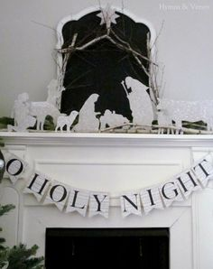 Black and white Christmas decor perfection.---if only I had a beautiful mantle to decorate. LOVE this.