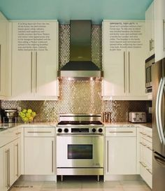 love how the cabinets/counter tops match, and the tile stands out.  Not sure if I could handle that much shine on the tile though....
