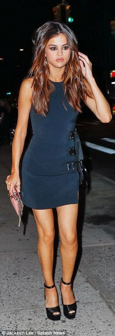 Fashionista: Selena Gomez, 24, sizzled in a figure-hugging navy dress (L) after flaunting ...